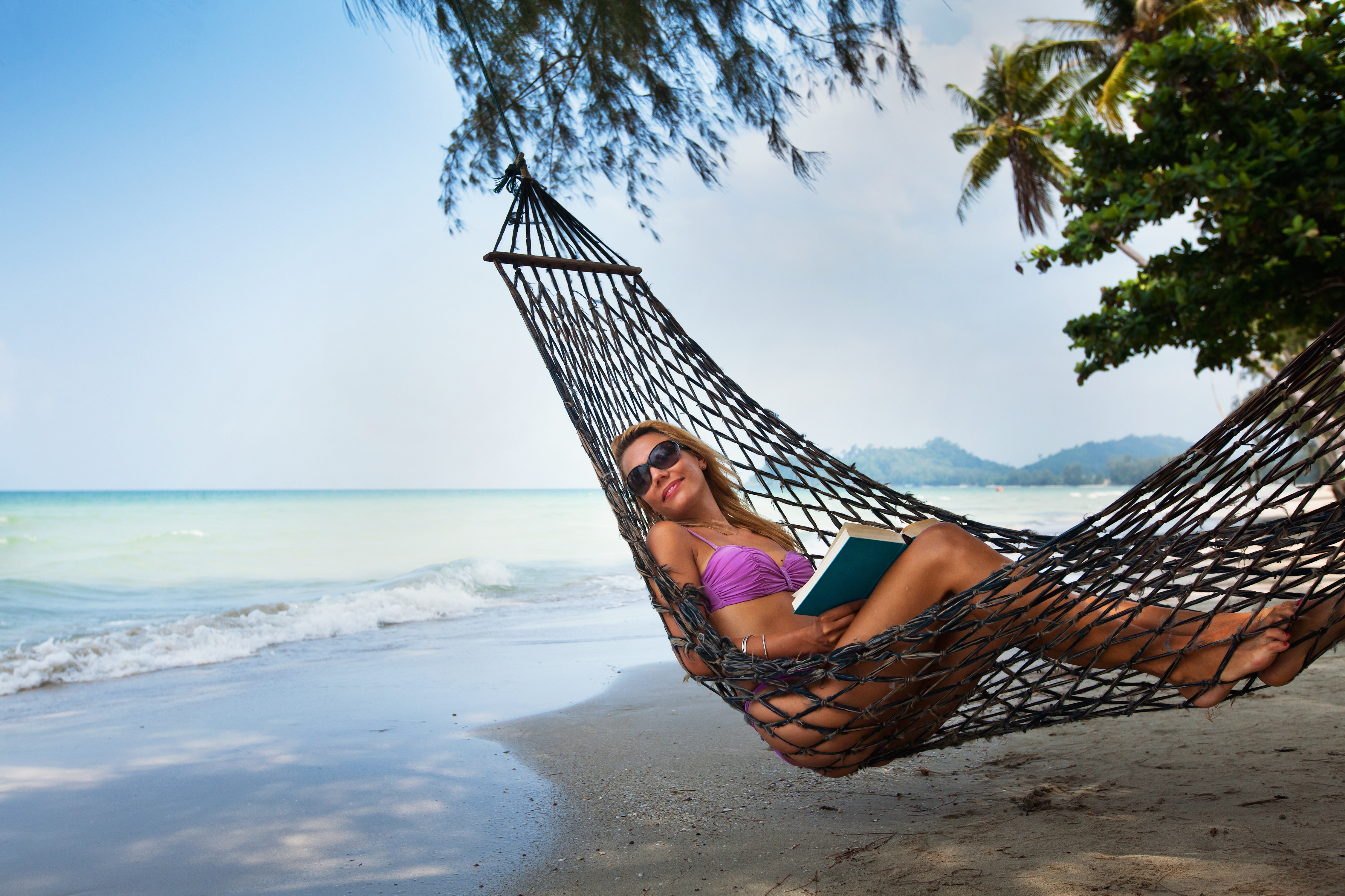 young attractive sexy woman in hammock on the beach